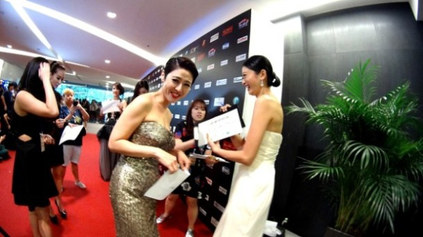 Cynthia Koh wears a silver strapless gown